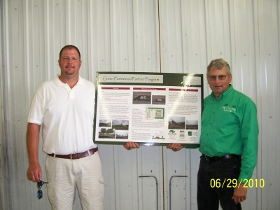 The picture above is of Ryan Reed (left) of Ottumwa, Iowa, and his tree planting around his hog buildings that we helped design and supplied the trees for. With their planting of trees and other things Ryan and Lana have done they were awarded the 2012 Pork Industry Environmental Stewards award. Click on the right link to see pictures, article and video on what they have done to deserve this honor of a pork producer. Aerial picture shown right.