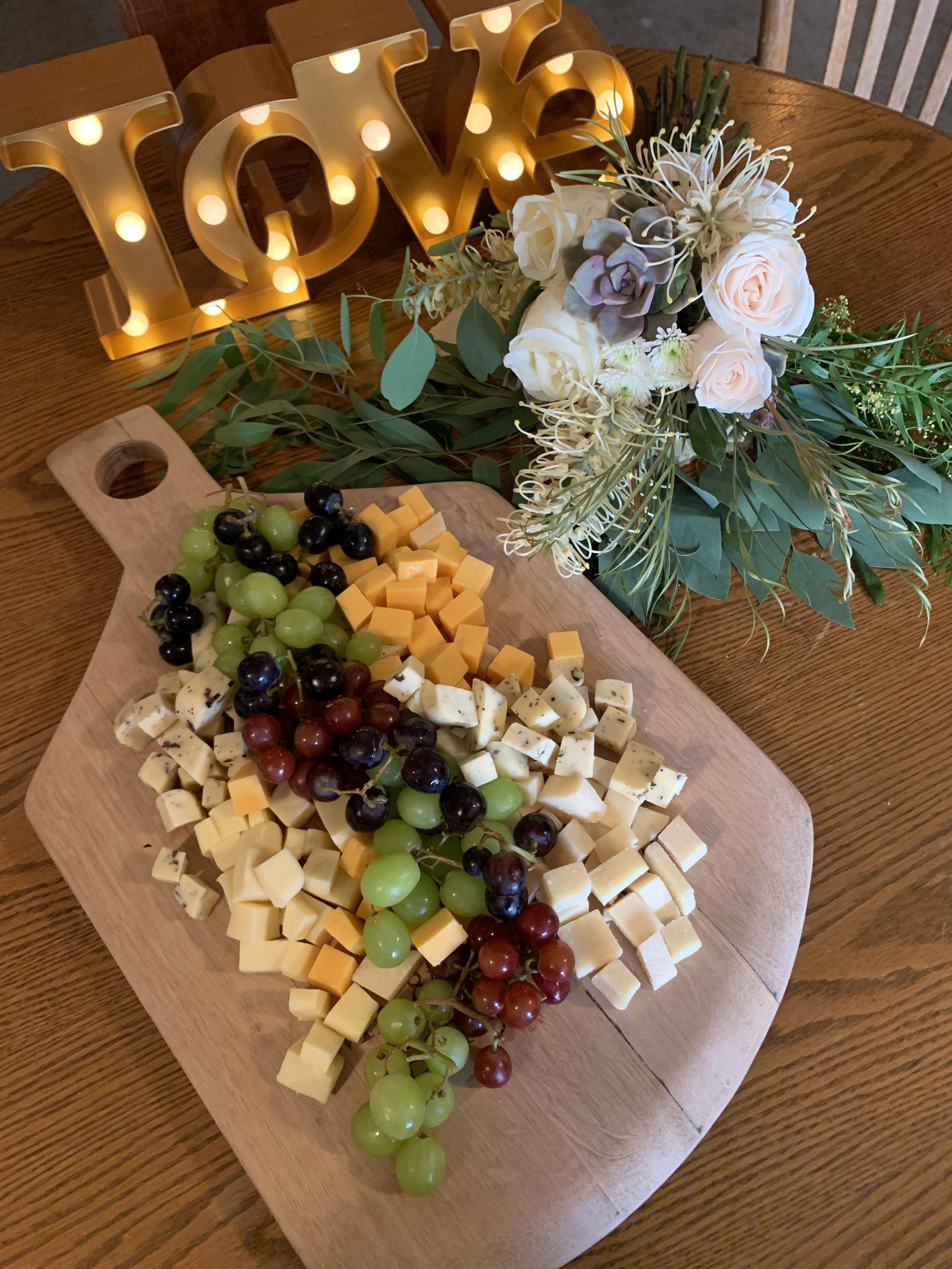 Florals and custom cheeseboard  Rustic Wedding 2019