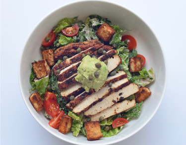 Blackened Chicken Kale Caesar - Romaine & kale, blackened chicken, cherry tomatoes, avocado, whole grain croutons, house-made caesar dressing (Contains nuts)