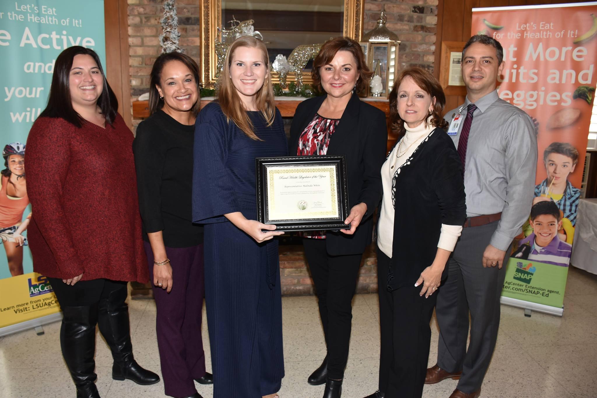 Representative Malinda White, receiving the Rural Health Association 2018 Legislator of the Year award