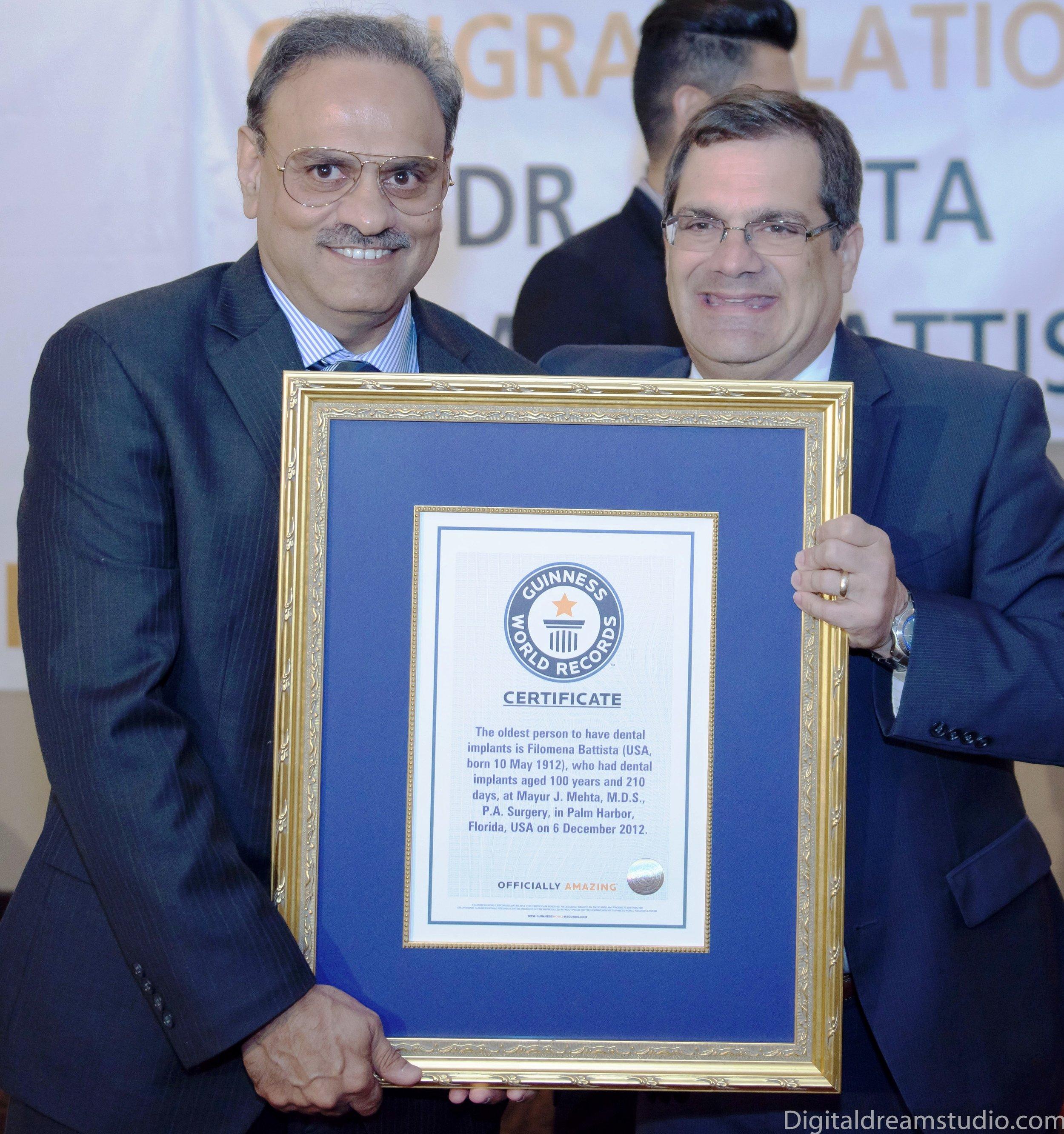 Dr. Mehta receives Guinness World Record certificate from Gus Bilirakis