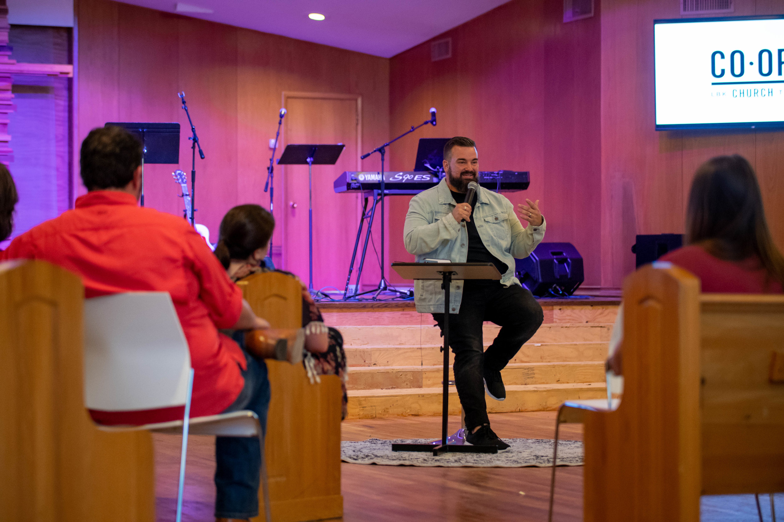 Justin Stice preaching on CO-OP Church's first Sunday.