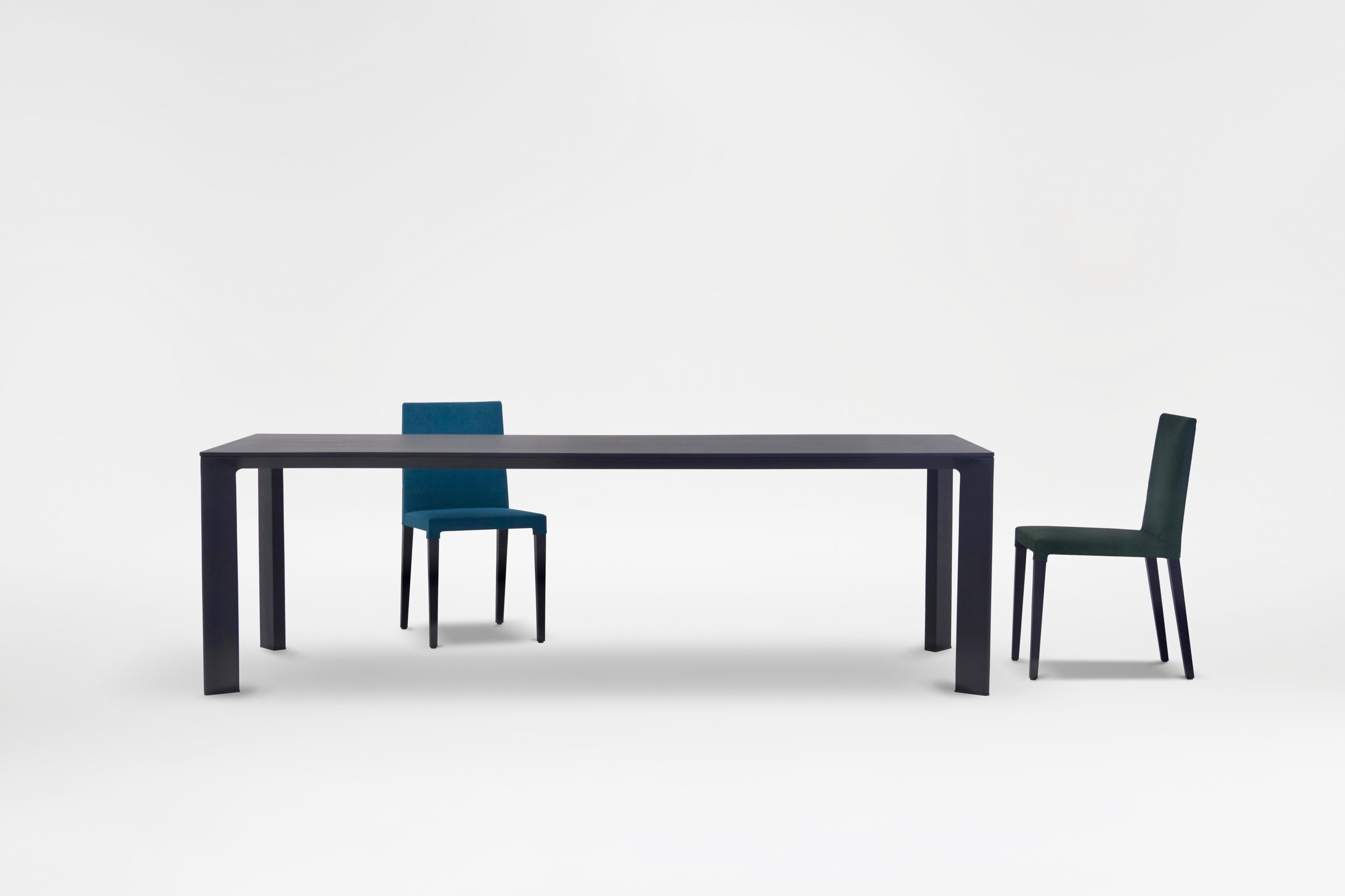 Joint dining table - Perpetually modern, Joint Dining Table exhibits a striking stance that is sculpturally stunning from every angle.