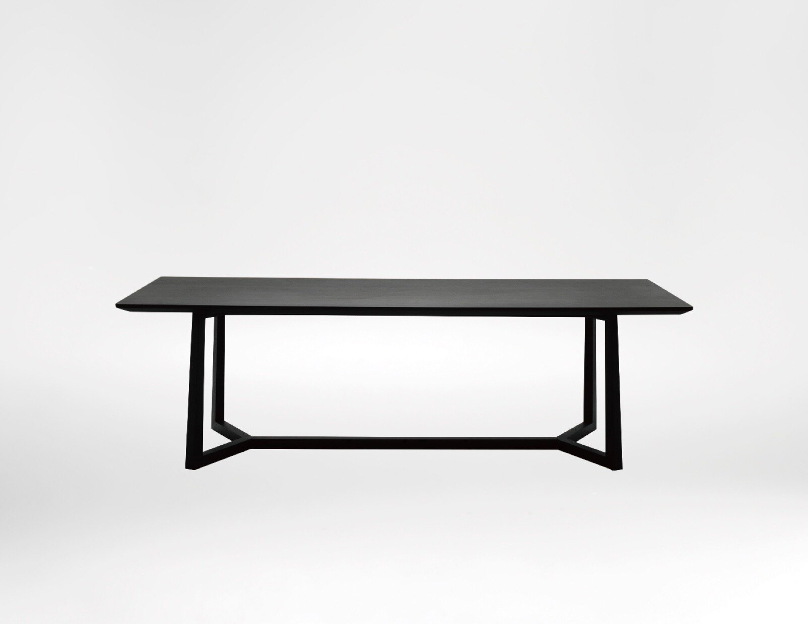 Vessel Dining table - Precise angular lines and slim delicate legs make the Vessel modern designer dining table is one of unrivalled beauty.