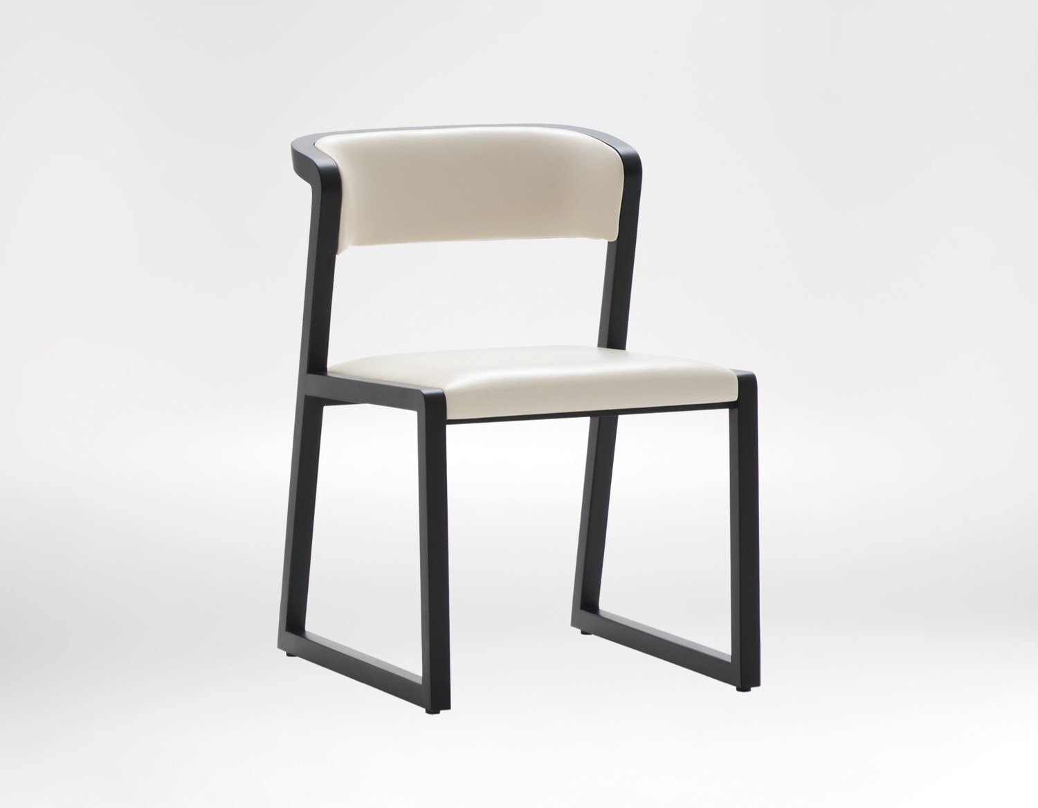 Ming chair - Designed around the contours of the body, it emanates perfectly formed sophistication.