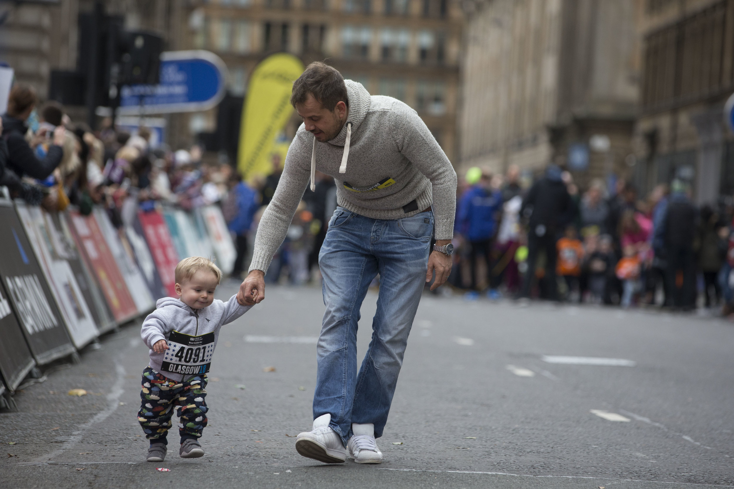 Isaac & Craig during the Great Scottish Run Toddler Dash. Isaac had only recently started to walk and this was his first 'race'. One of Craig's proudest moments as a Dad, even though the wee man was pipped at the post into last place by a kid dressed as Superman. And yes, Dad did shed a tear!  Image Credit: Great Scottish Run.