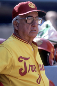 Rod Dedeaux  University of Southern California  Dedeaux coached the Trojans for 45 years before retiring in 1986 with a record of 1,332-571-11, the most wins in Division I history until Cliff Gustafson of Texas surpassed him in 1994. Dedeaux led his team to 10 College World Series titles, including five consecutive from 1970-74. His Trojans won 28 conference titles. Nearly 60 USC players under Dedeaux went on to big league careers, including Mark McGwire, Randy Johnson, Tom Seaver, Dave Kingman, Fred Lynn and Roy Smalley.