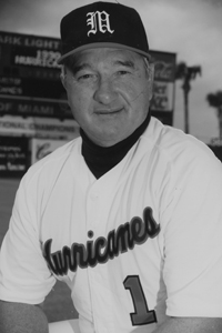 """Ron Fraser  University of Miami  Fraser won just about every honor, including NCAA national titles in 1982 and 1985. He left the coaching ranks as second winningest all-time coach with a 1,271-438-9 (.747) record. His UM teams set an NCAA record with 20 consecutive playoff appearances. His career at Miami spanned more three decades, with 12 trips to the College World Series. A 26-time coach of the year, he is a member of five halls of fame. Ron Fraser's uniform No. 1 was retired on April 24, 1993. He was the first Team USA coach when baseball was a medal sport at the 1992 Summer Games. He was known as """"The Wizard of College Baseball"""" for his marketing innovations, including a """"Night with Ron Fraser,"""" a $5,000 gourmet dinner on the infield that included Alaskan king crab and pheasant under glass."""