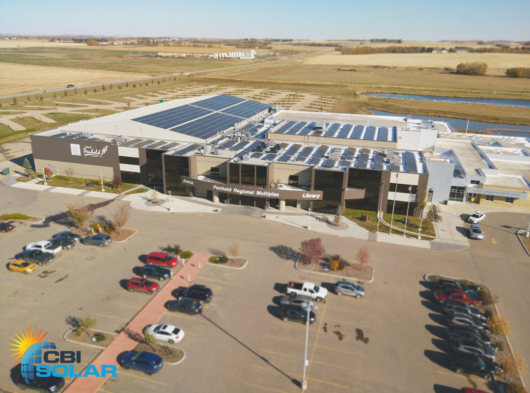 PENHOLD MULTIPLEX - 436.8 kW system on the roof of the Penhold Multiplex in Penhold, Alberta. 1092 PV modules.