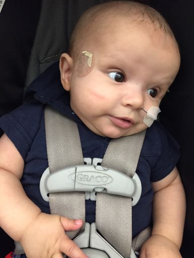 Whit in carseat | Trilateral Retinoblastoma Story