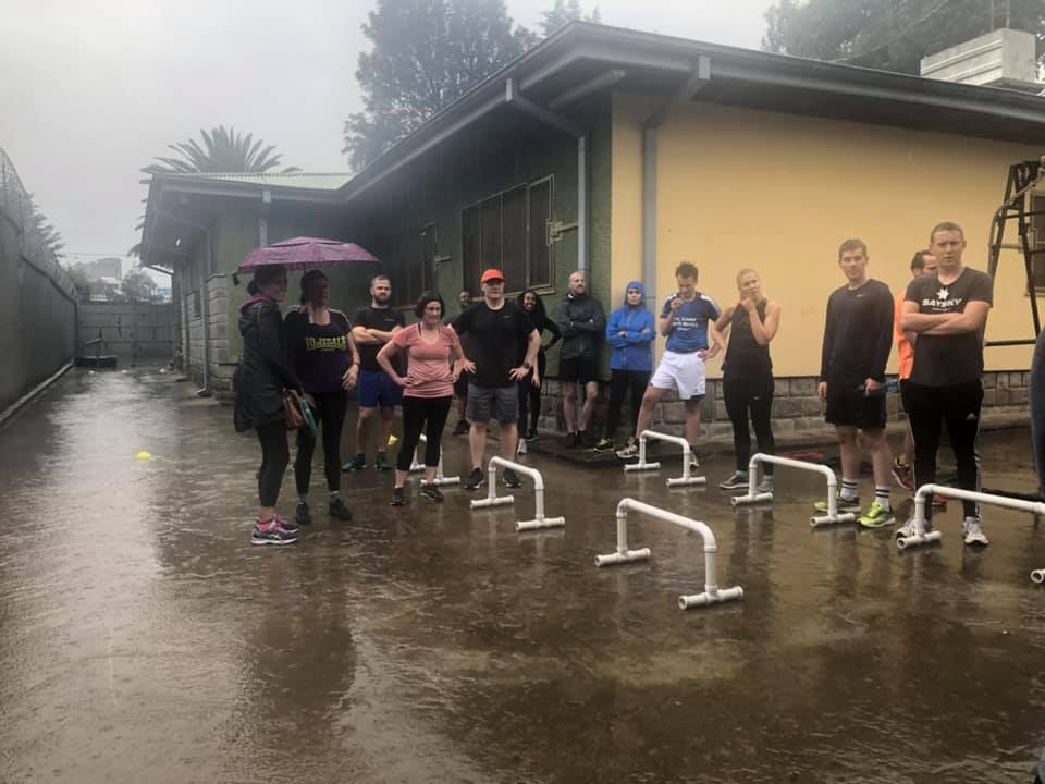 Getting HIIT instructions while getting soaked. (Photo credit to Melissa Varma)