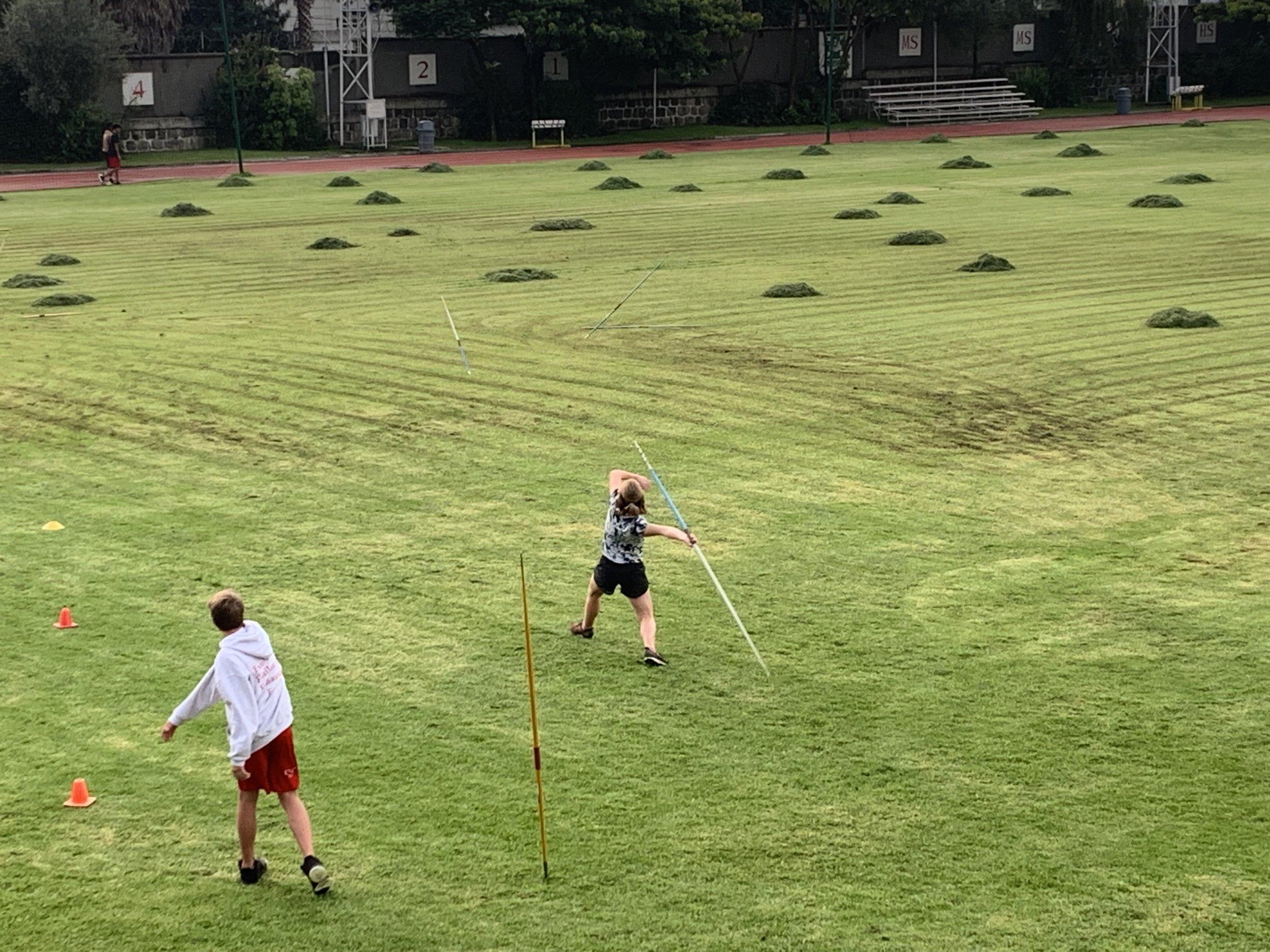 The view of practice from the parents viewing platform. The wind-up shown above. Followed by the throw below.