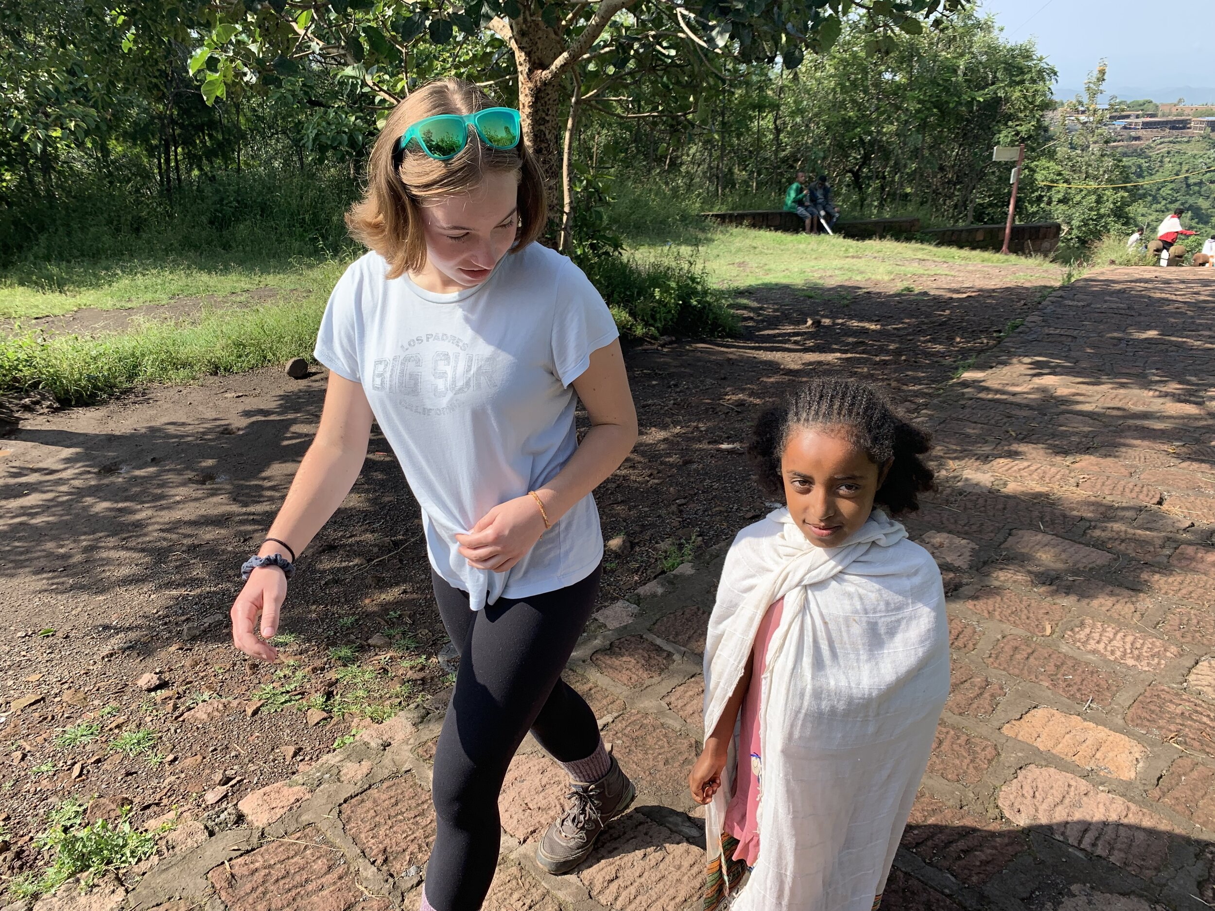 Kids approach us everywhere. This girl (Hannah) was different. Her curious, sincere conversation with Maya on the walk between church clusters was a treat for us all.