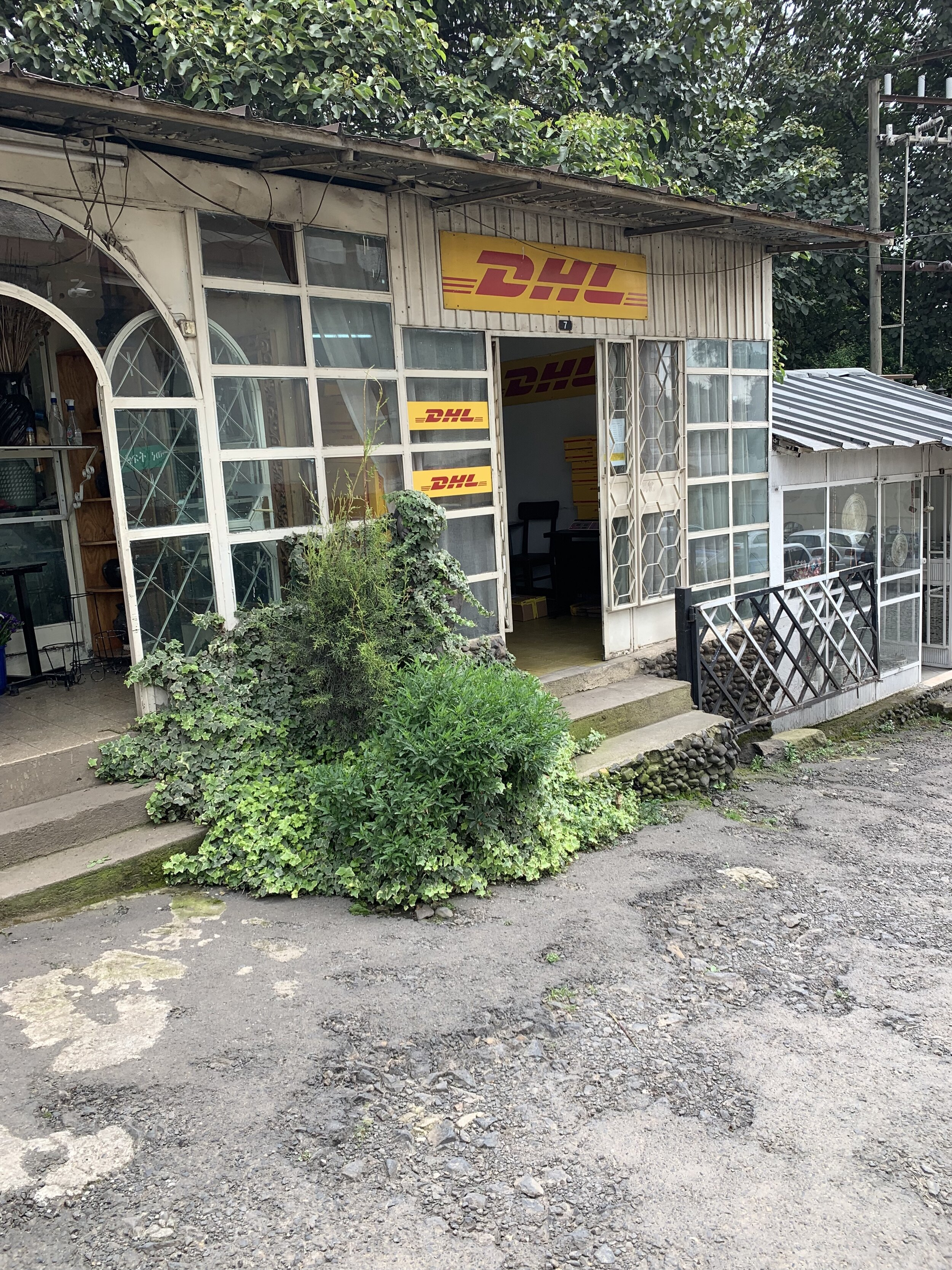 """The private industry option in our neighborhood, that we'll most likely also try out at some point. I was told this DHL office """"opens at two."""" Which in Ethiopia time is 8am."""