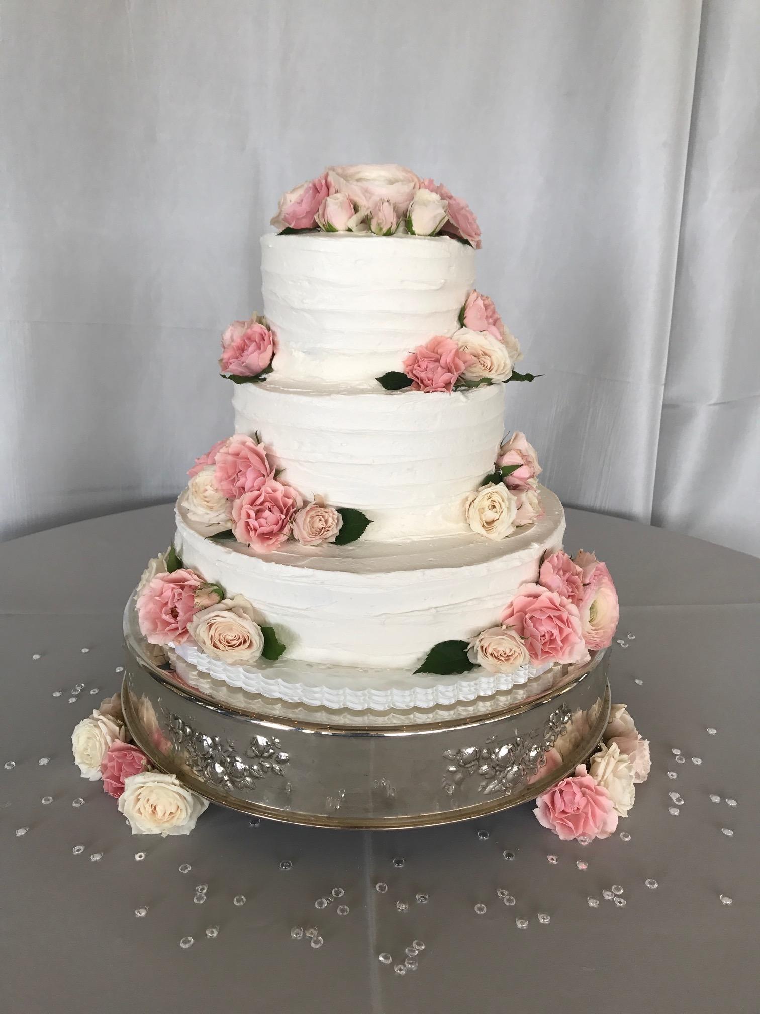 3 tier rustic sides pale pink and ivory random flowers.jpg