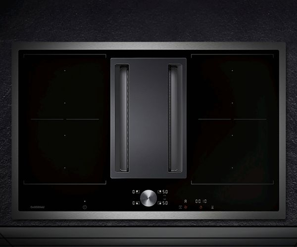 Induction with downdraft ventilation