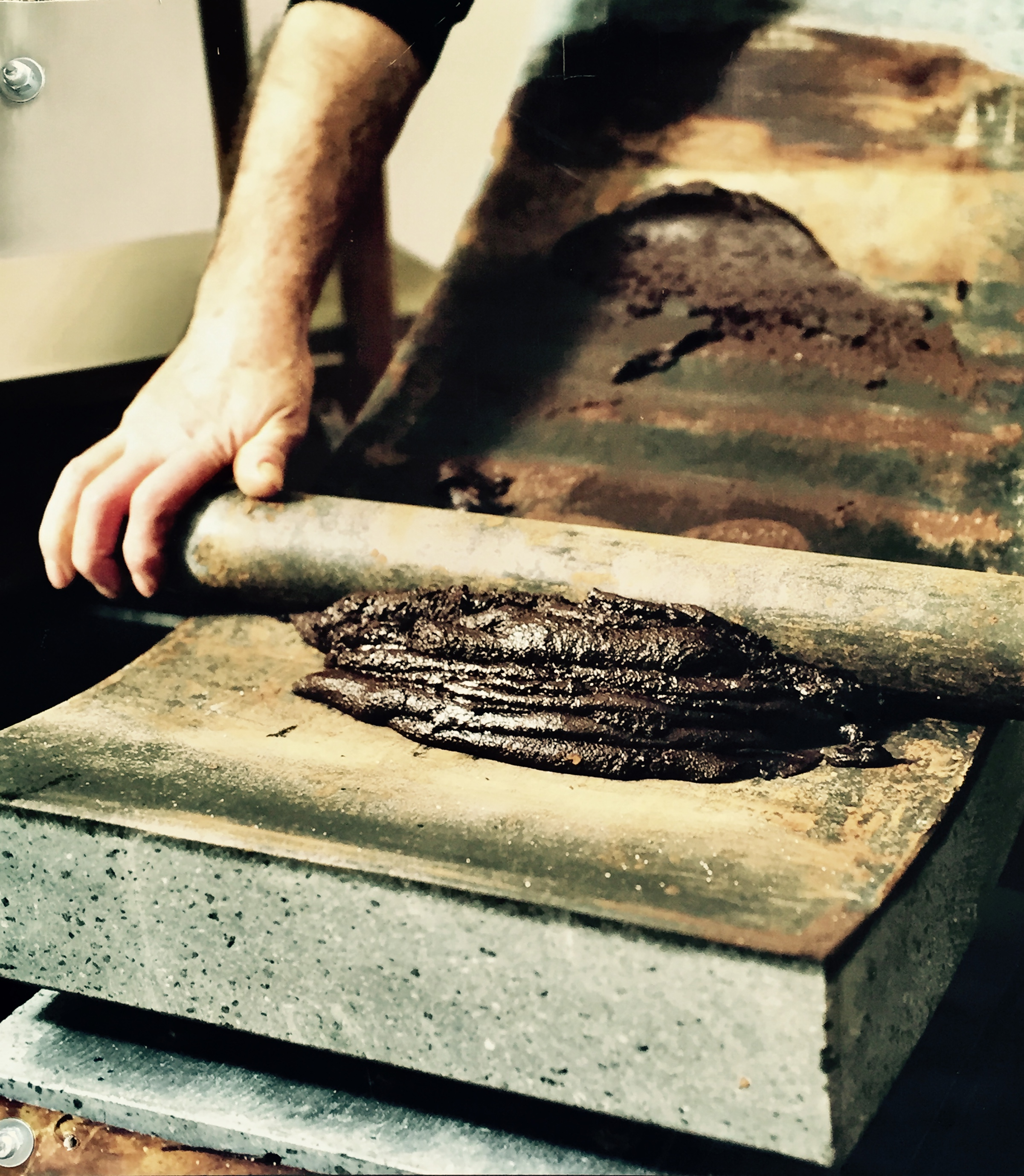 Matete used to hand grind cocoa beans for making chocolate