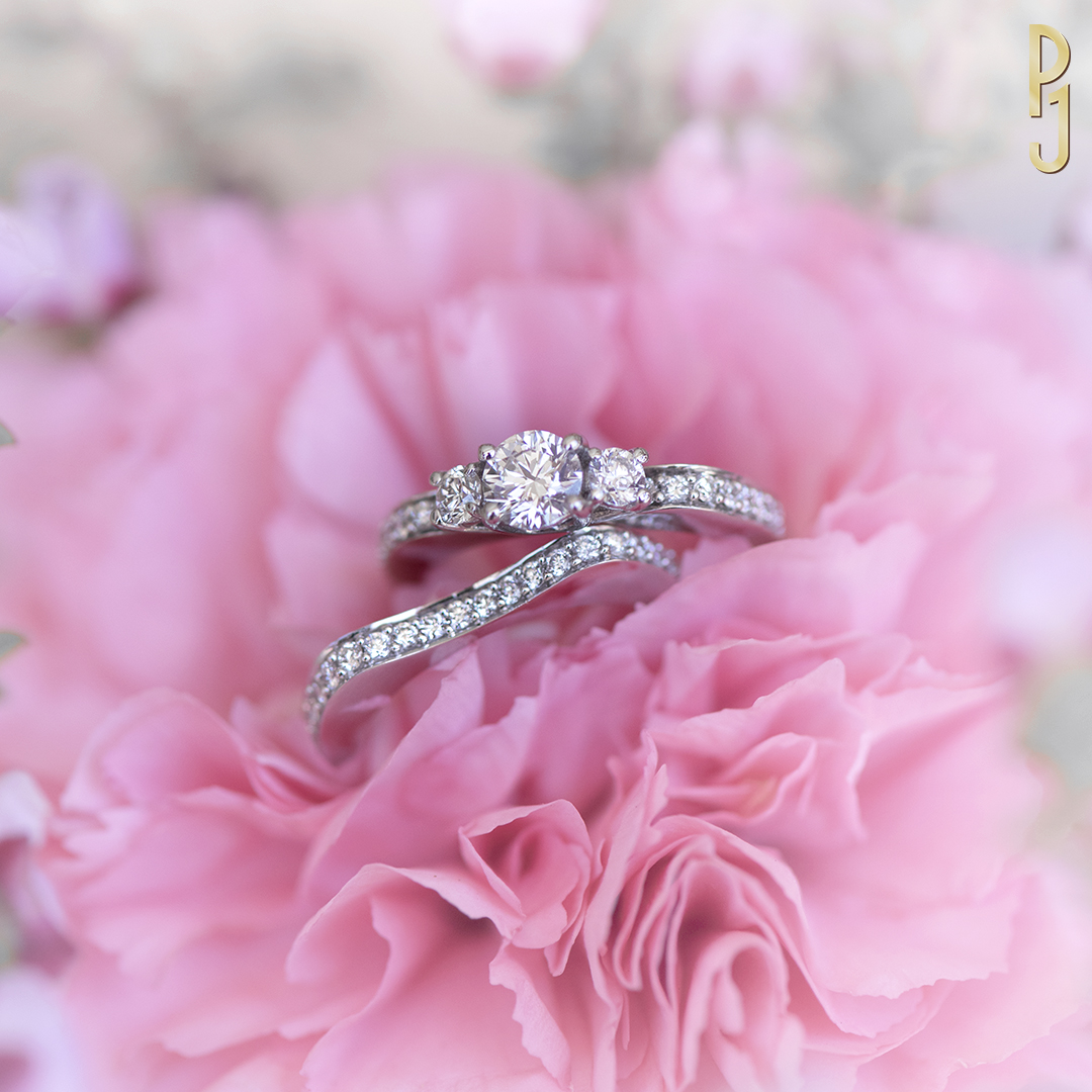TRILOGY BRIDAL SET - Set in 18ct. white gold a 50pt. G/SI1 centre diamond is accompanied by 2 x 11pt. diamonds + 34 additional diamonds = 40pts. Comes with the matching wedding band.