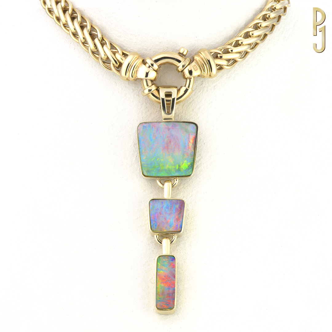 BOULDER OPAL - Pendant: Three Boulder opals set in 9ct. yellow gold.Origin: Winton, QueenslandDesigned & handmade by Philip.