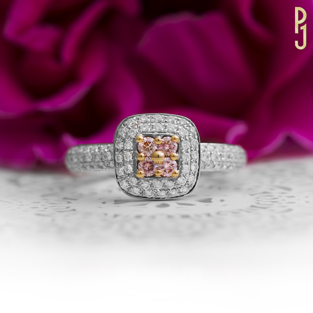 PINK DIAMOND CUSHION - Featuring 4 x 5pt 6P Argyle pink diamonds. The rose gold beads add the perfect complement to this 18ct white gold and diamond halo style ring.
