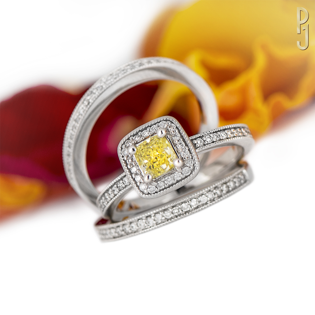 FANCY YELLOW DIAMONDBridal Set - This stunning natural fancy intense yellow cushion cut diamond is set in 18ct white gold with an additional 38 white diamonds. Also comes with the matching wedding band and an eternity ring.