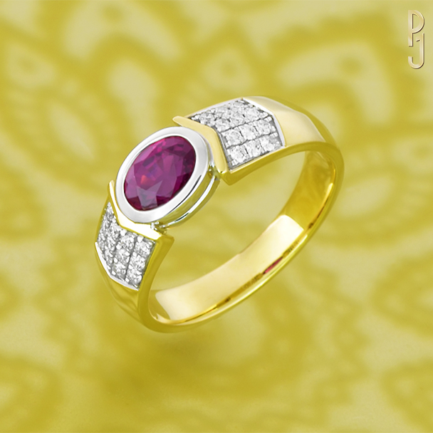 BURMESE RUBY - Ring: Burmese ruby, oval shape, 1.06ct. plus 24 pavé set diamonds = 20pts. set in 18ct. yellow and white gold.