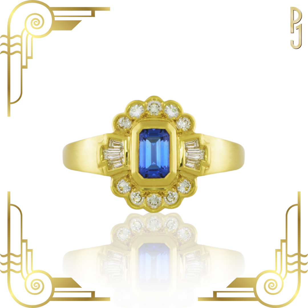 CEYLON BLUE - Ring: Ceylon sapphire, emerald cut, 78pt. plus diamonds 6 tapered baguettes and 10 round diamonds = 40pts. set in yellow gold.An Art Deco inspired piece designed by Philip.