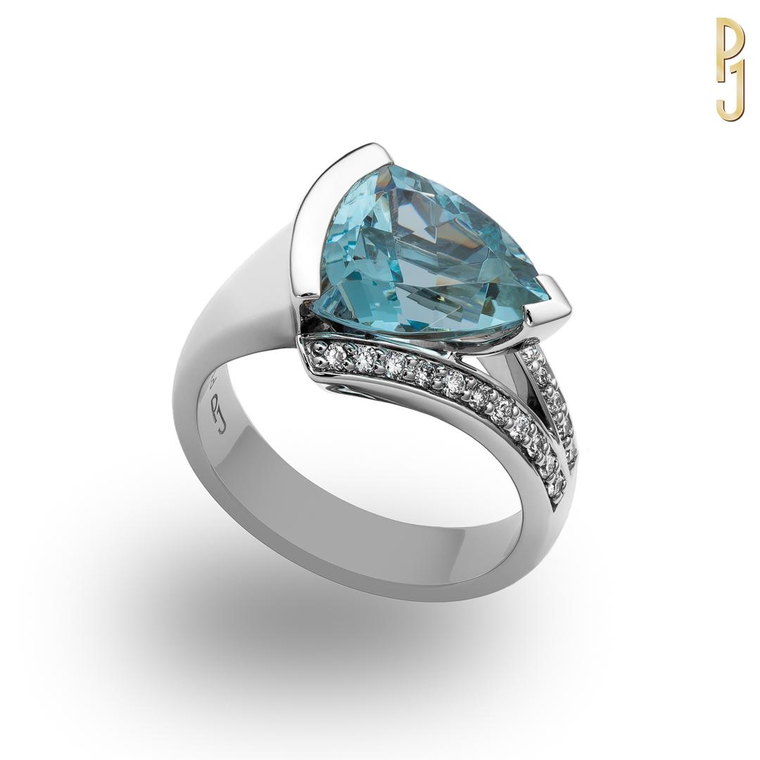 AQUAMARINE - Aquamarine is the birthstone of those born in March.Ring: Aquamarine, trillion cut, 3.61ct. plus 22 x 1pt. diamonds set in platinum.Designed and handcrafted by Philip.
