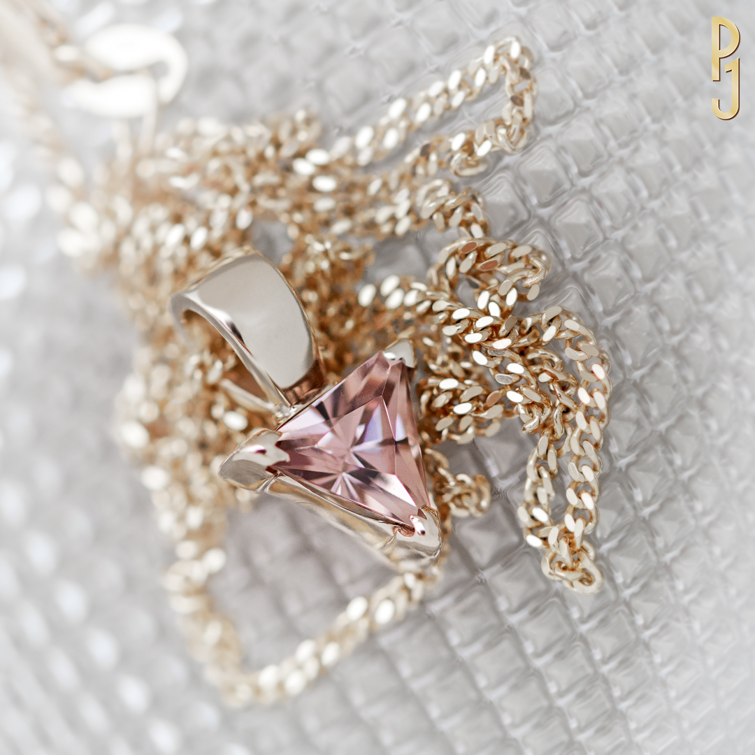 ZIRCON - Pendant: Zircon, dusty pink, triangle cut, 1.8ct. set in 9ct. yellow gold.Designed and handcrafted by Philip.