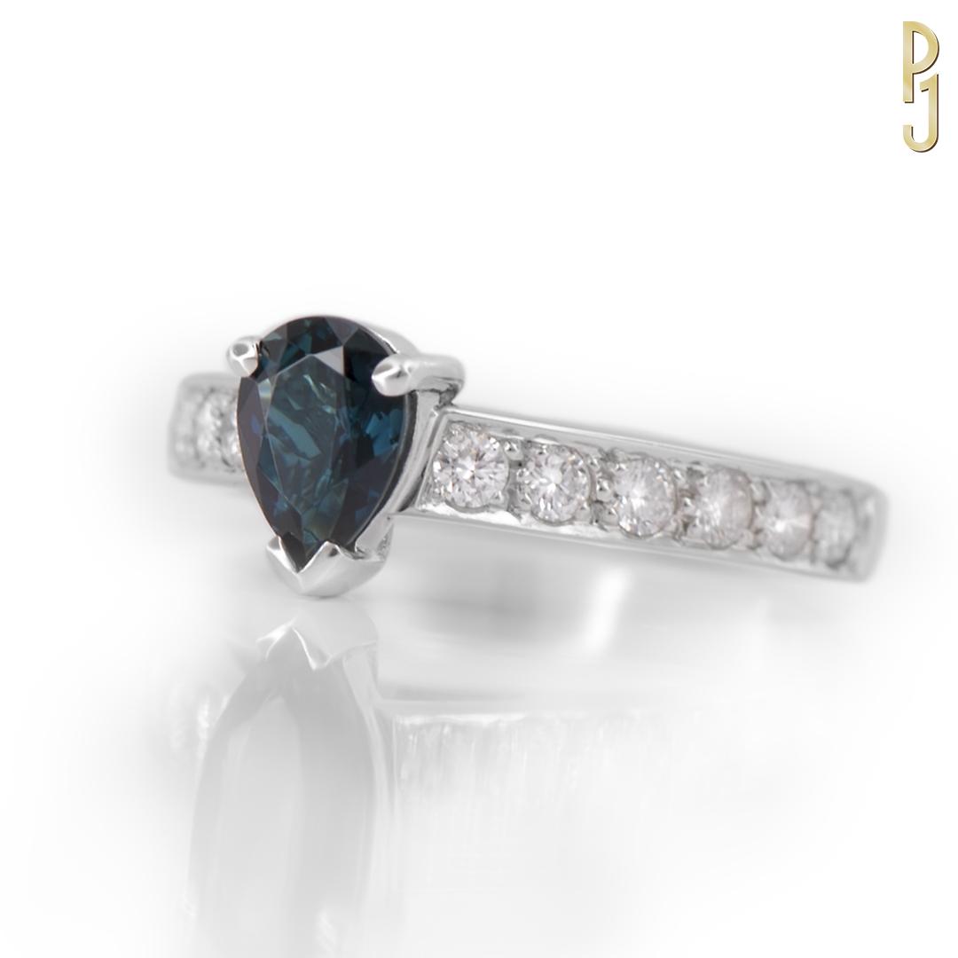 BLUE TOURMALINE - Ring: Blue tourmaline, pear shape plus 12 diamonds = 43pts. set in 18ct. white gold.