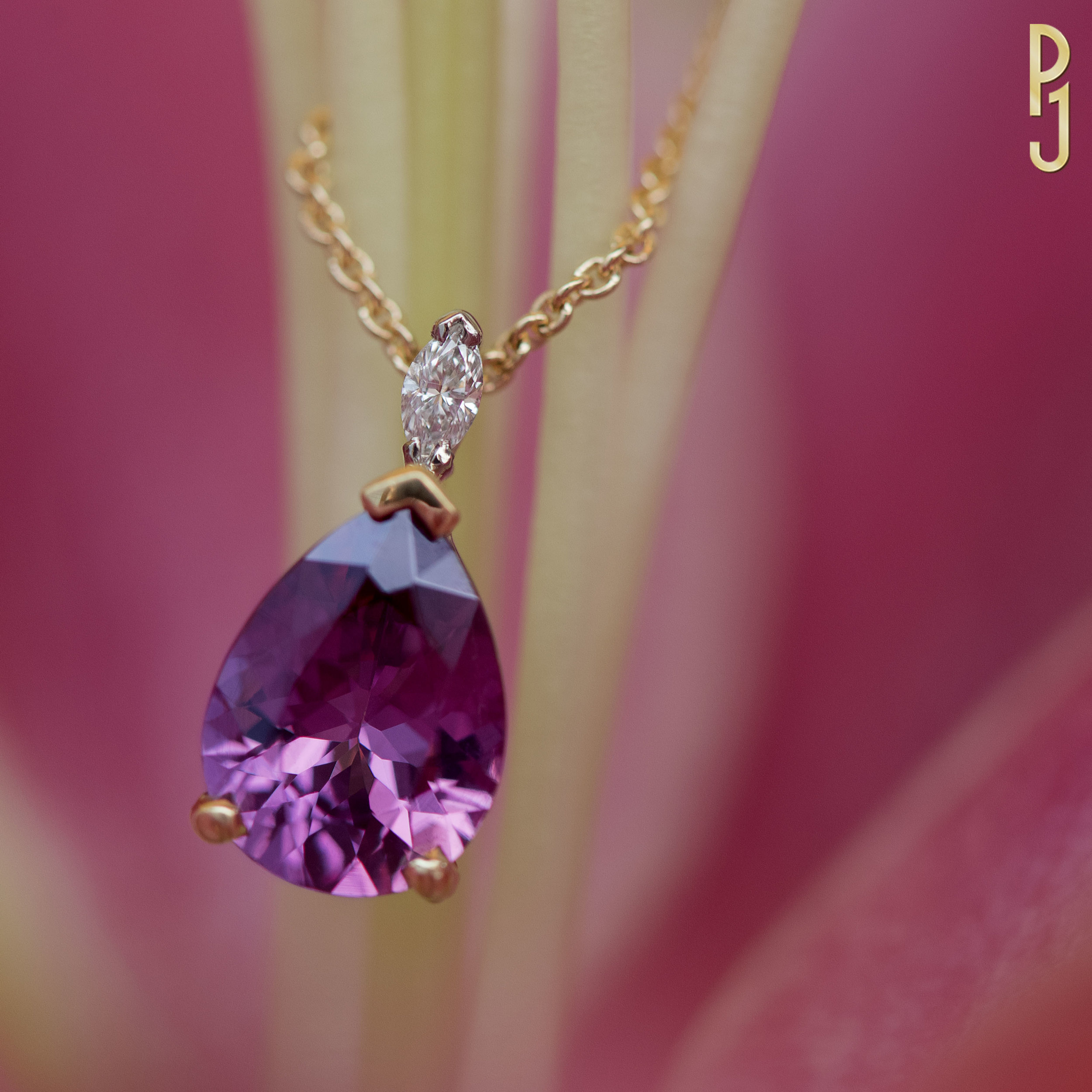 PURPLE GARNET - Pendant: Purple garnet, pear shape, 1.87ct. plus one marquise diamond = 5pts. set in 18ct. yellow and white gold.Designed and handcrafted by Philip.