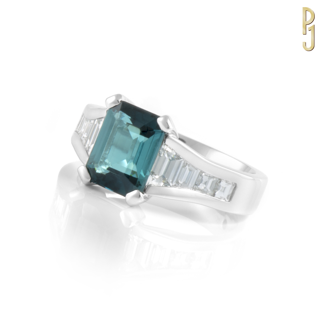 BLUE TOURMALINE - Ring: Blue tourmaline, emerald cut, 2.8ct. plus custom cut diamonds = 96pts. set in platinum.Designed and handcrafted by Philip.