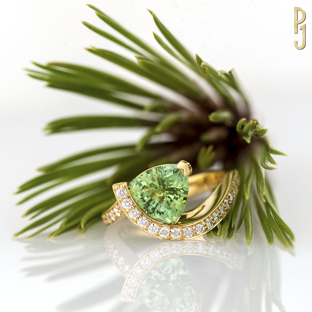 MINT TOURMALINE - Ring: Mint tourmaline, trillion cut, 2.51ct. plus 25 diamonds = 33pts. set in 18ct. yellow gold.Designed & handcrafted by Philip.