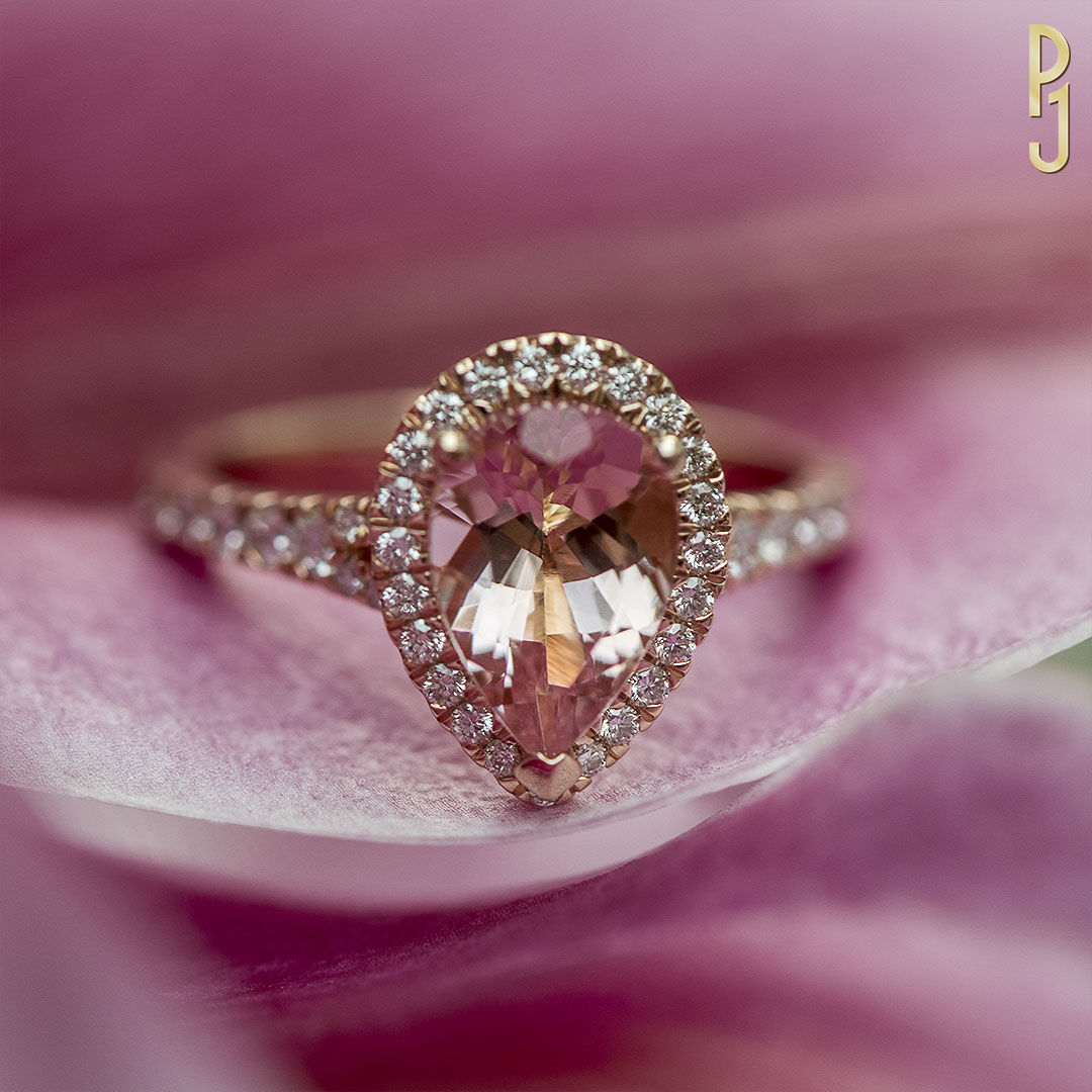 MORGANITE - Ring: Morganite, pear shape, 1.73ct. plus 47 F/VS1 diamonds = 51pts. set in 18ct. rose gold.Designed and handcrafted by Philip.
