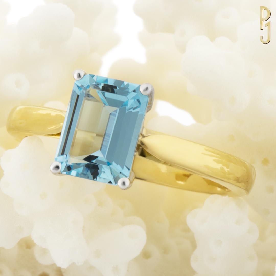 AQUAMARINE - Ring: Aquamarine, emerald cut, 1.35ct. set in 18ct. yellow gold.