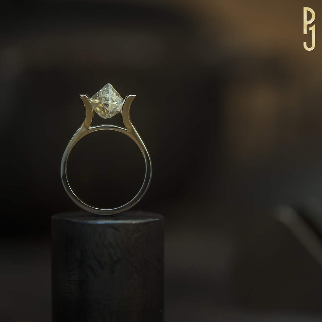 ROUGH DIAMOND - In its natural form this 2.42ct. un-cut diamond is tension set into a 9ct yellow gold ring.Designed and handmade by Philip.