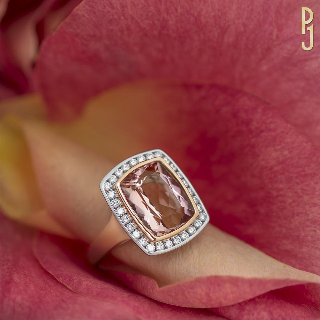 MORGANITE CUSHION - Ring: Morganite, cushion, 6.68ct. plus 30 diamonds = 47pts. set in 18ct. rose and white gold.