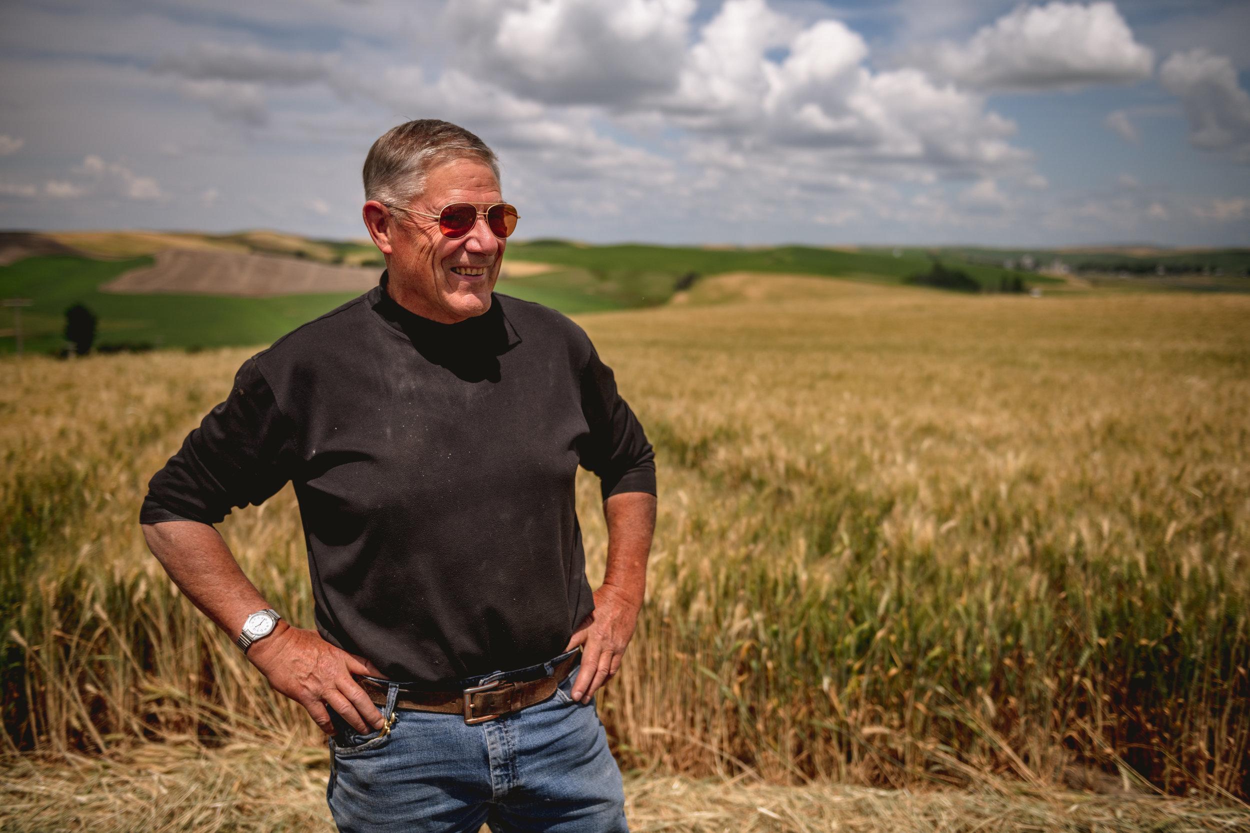 Bill Meyers in field of grain destined for malting