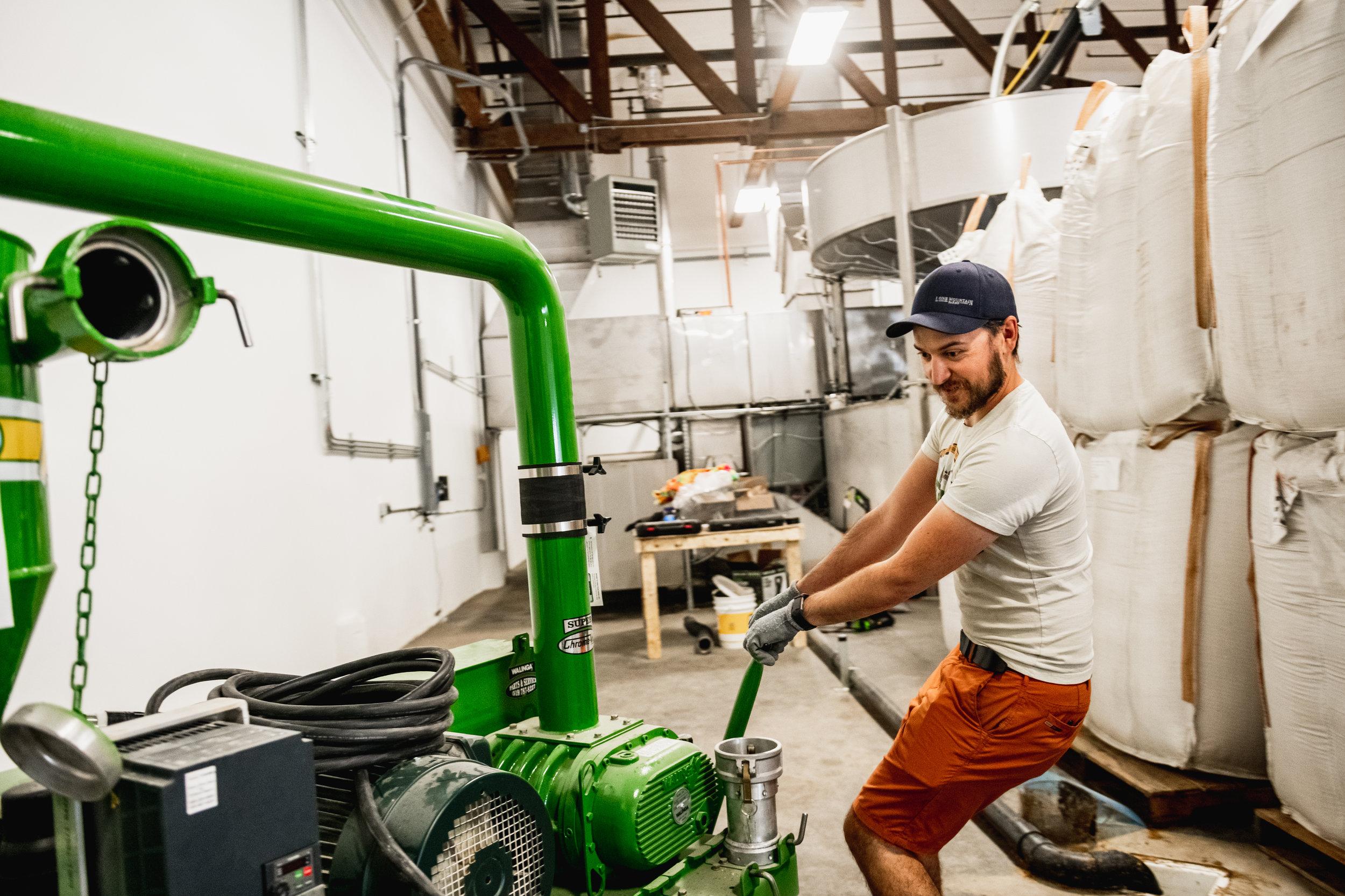 Joel Williamson working in the Spokane Valley malt house
