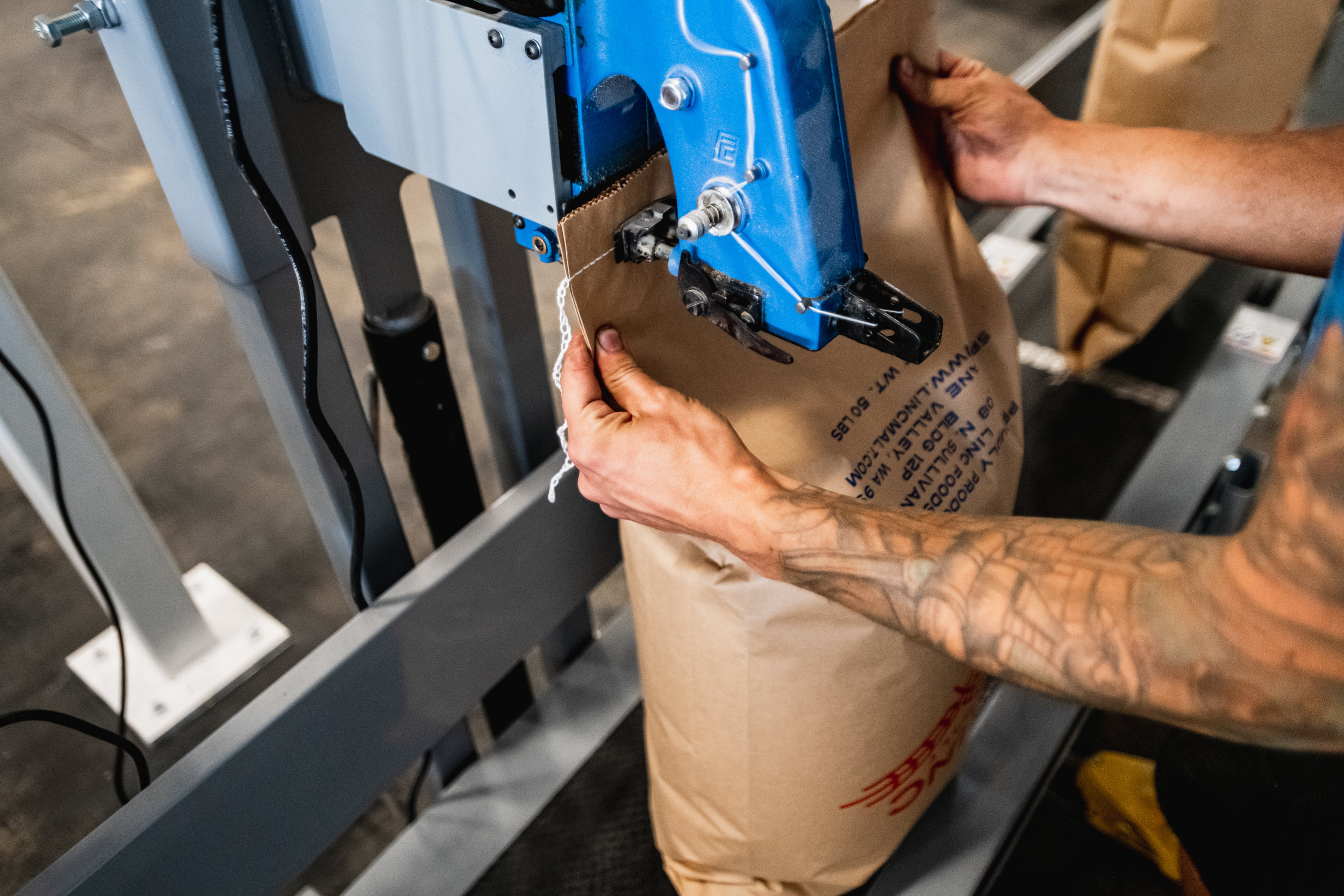 Worker bagging craft malt