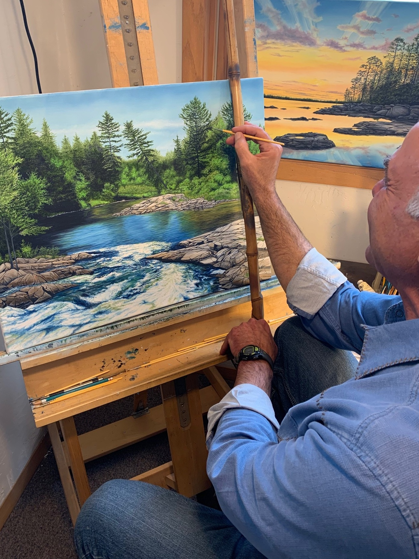 Owner and Artist Fred Bridenhagen - hard at work one of his newest paintings