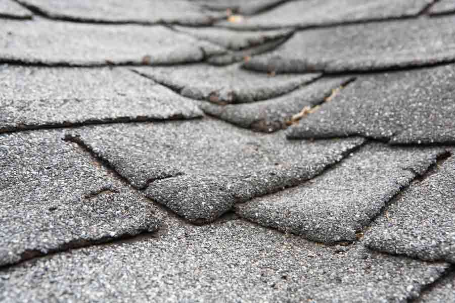 Repeated freezing and thawing can crack, heave, and curl shingles.