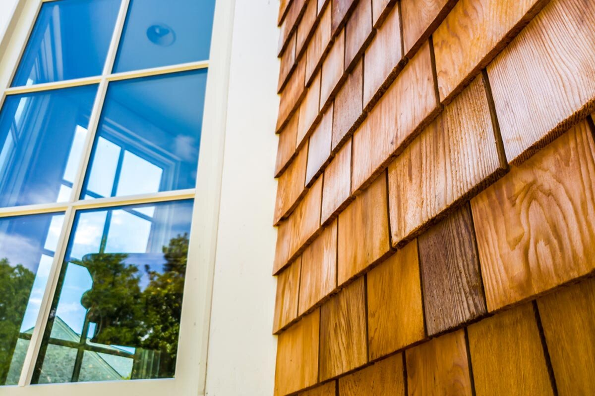 homeguide-cedar-shake-siding-panels-replaced-on-new-house.jpg