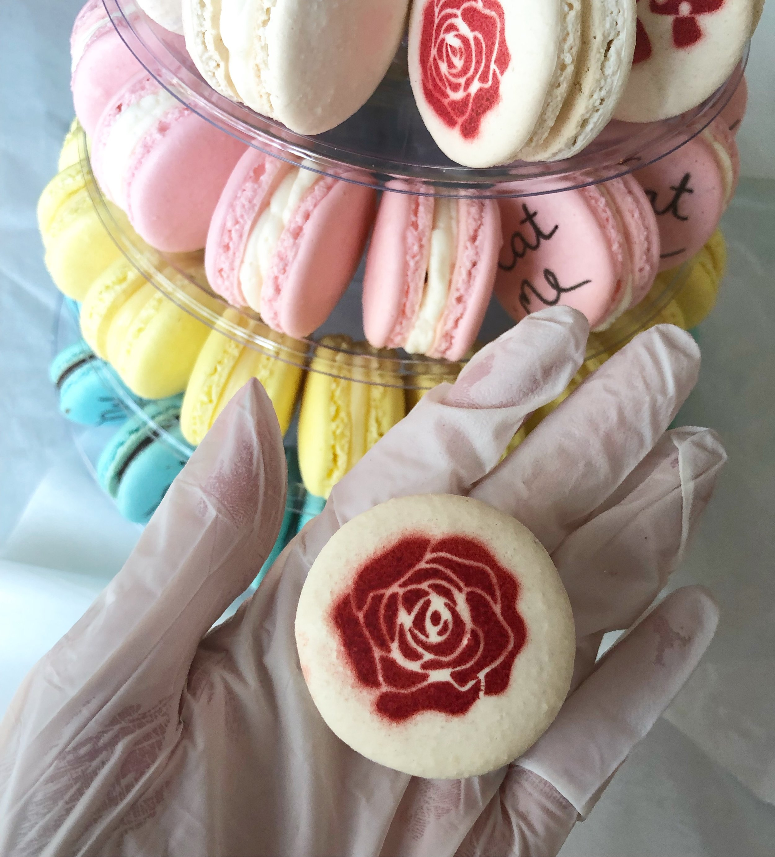 Macarons can be custom airbrushed or hand painted (or both) for custom designs, monograms, meaningful symbols, and more
