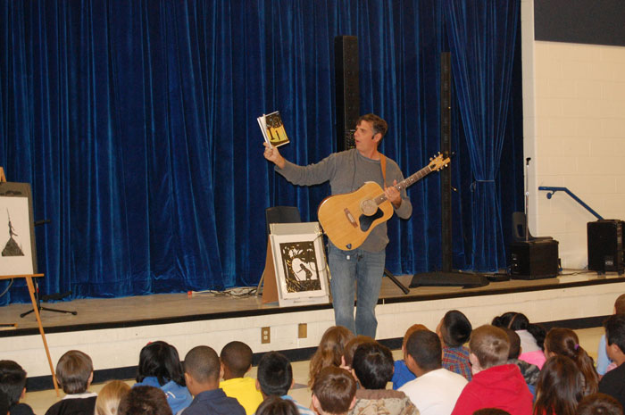 Silhouette artist and children's author Clay Rice performing on stage