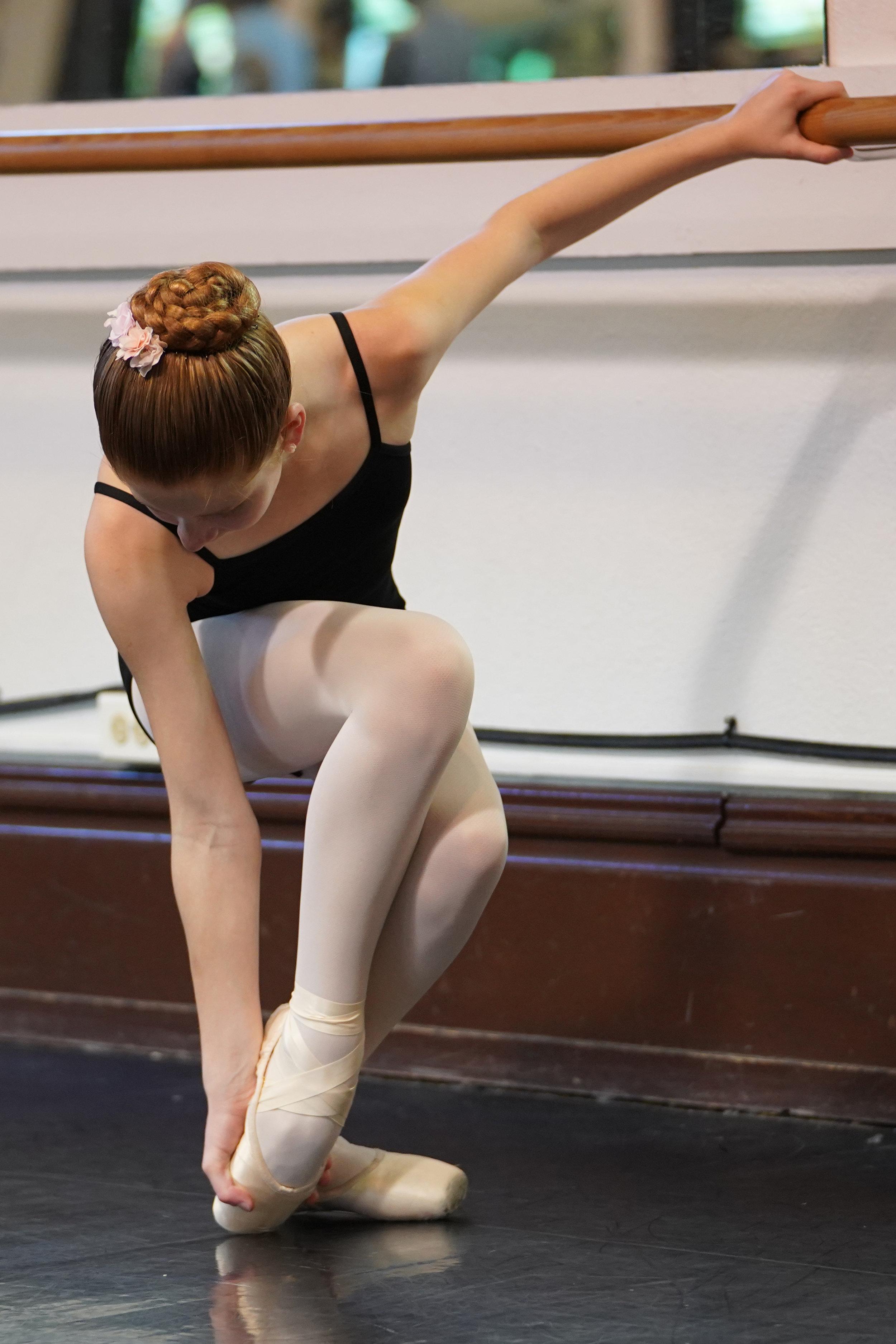 Dancer breaks in pointe shoes