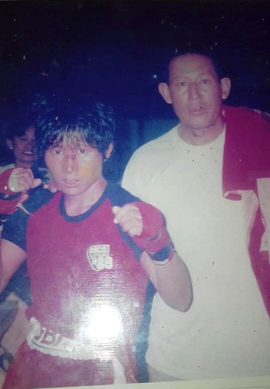 Kyu Kyu Thin, a successful boxer active 25 years ago. Seen here with coach Patma Sein.
