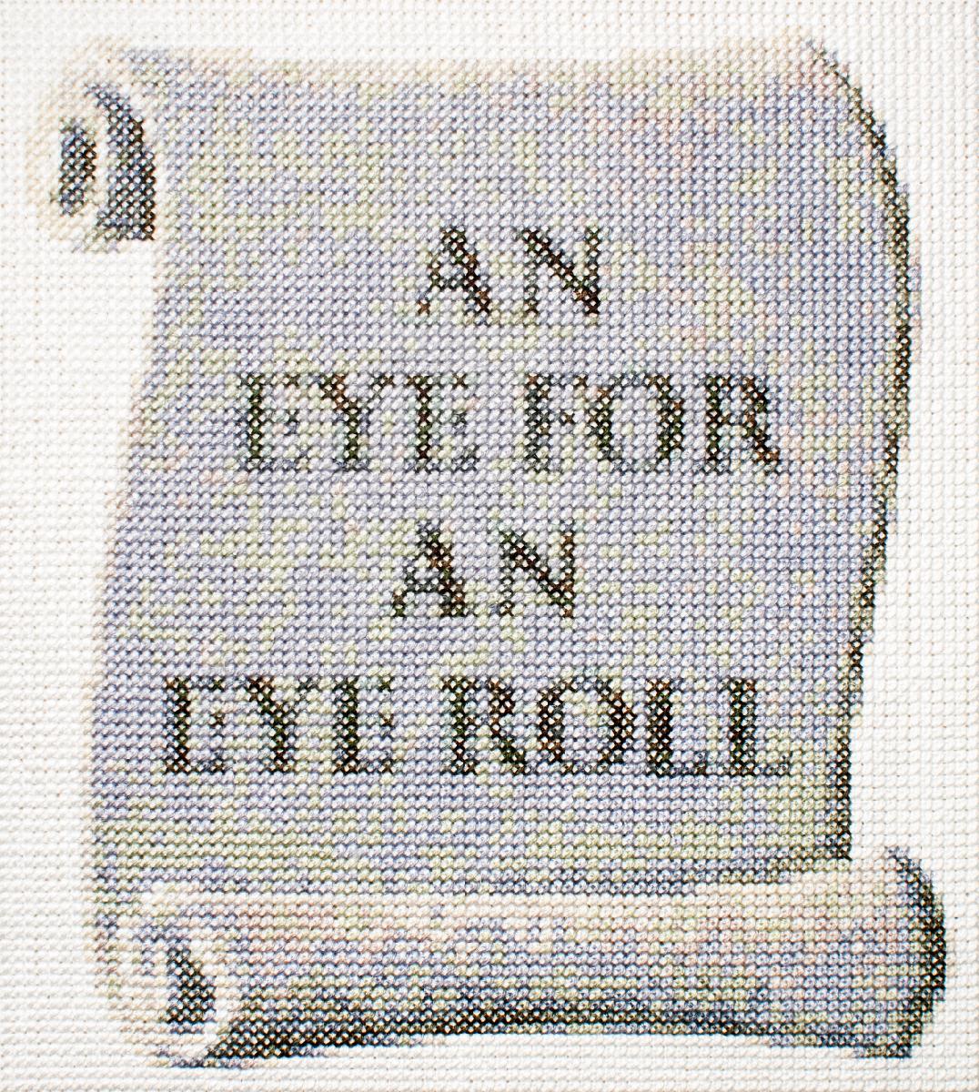 AN EYE FOR AN EYE ROLL   Cotton thread on aida cloth  8.2 x 7.25 inches  2017
