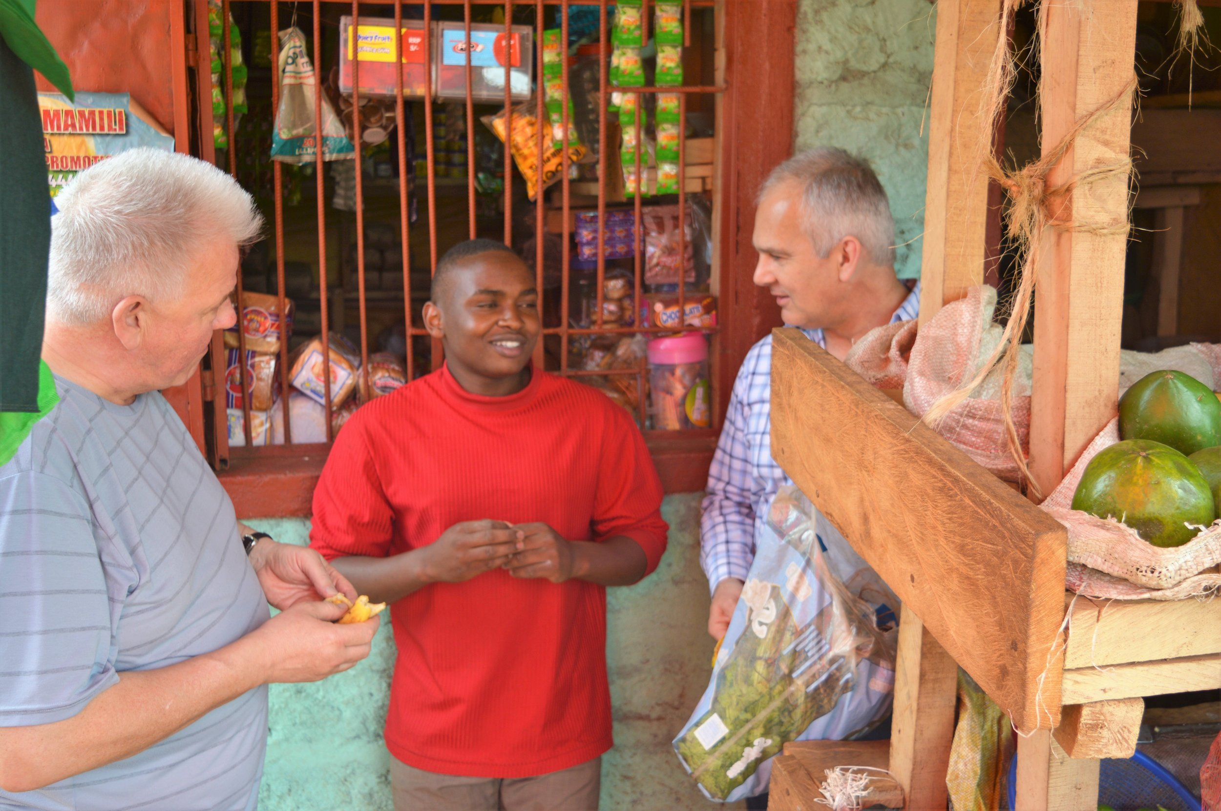 Simon and Dan, two of our Advisors, talking to Peter - an entrepreneur working with TechnoServe in Kenya