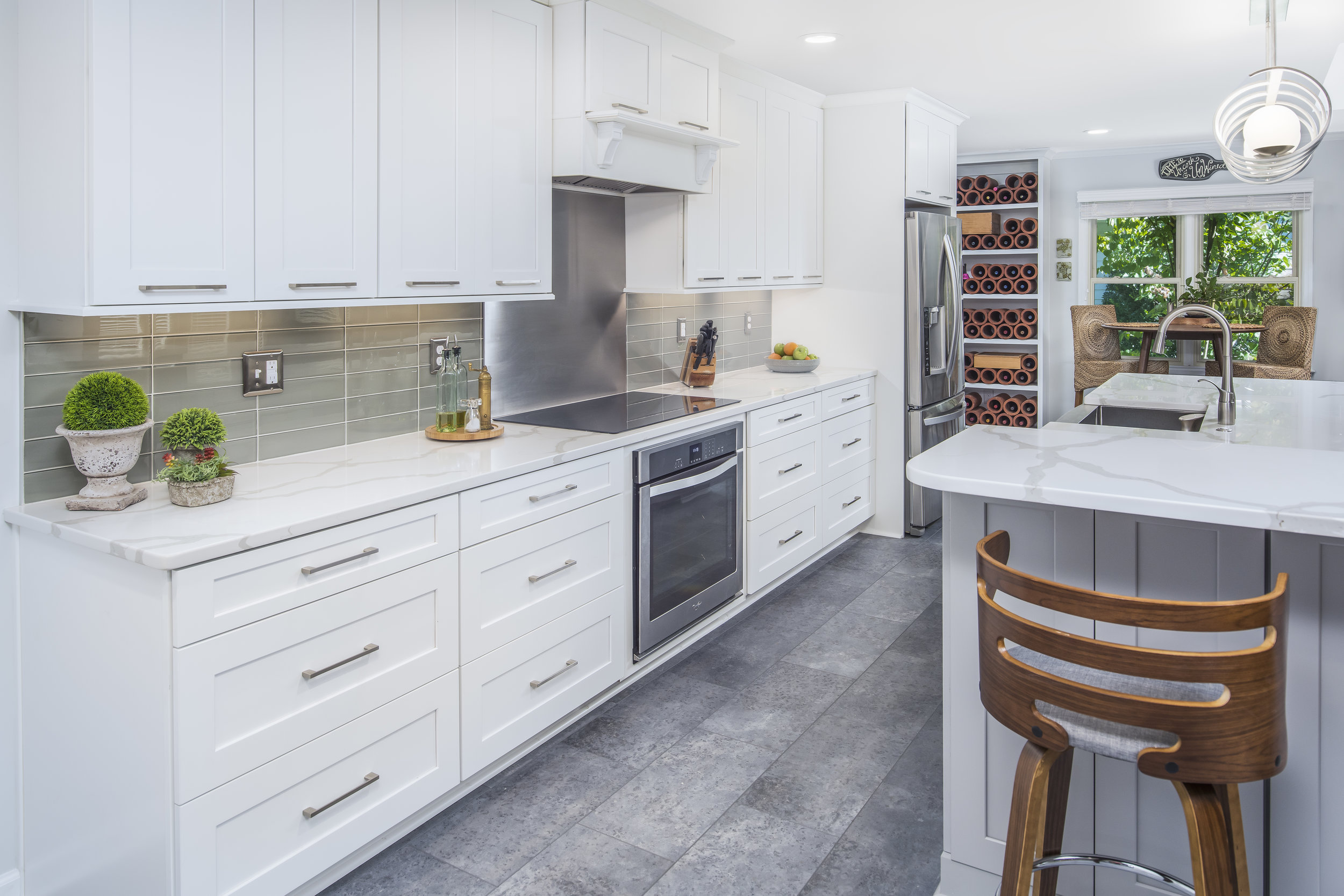 kitchen remodel with cabinets, recessed lighting, island, bar seating